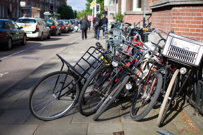 Bicycles in Amsterdam by Flickr user _dChris. Commercial use permitted by Creative Commons license.