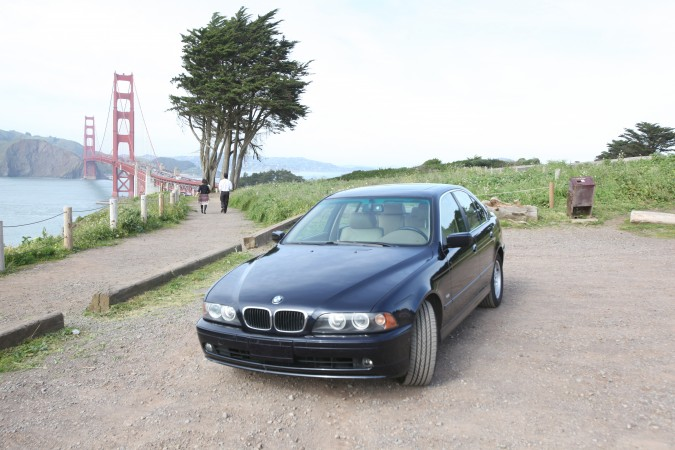 Kevin's BMW 525i in front of Golden Gate Bridge