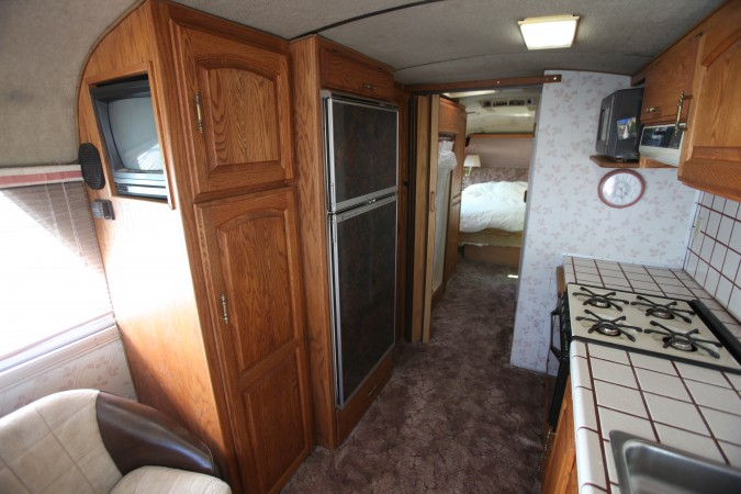 1967 MCI 5A Challenger, TV, refrigerator, closets and shower stall