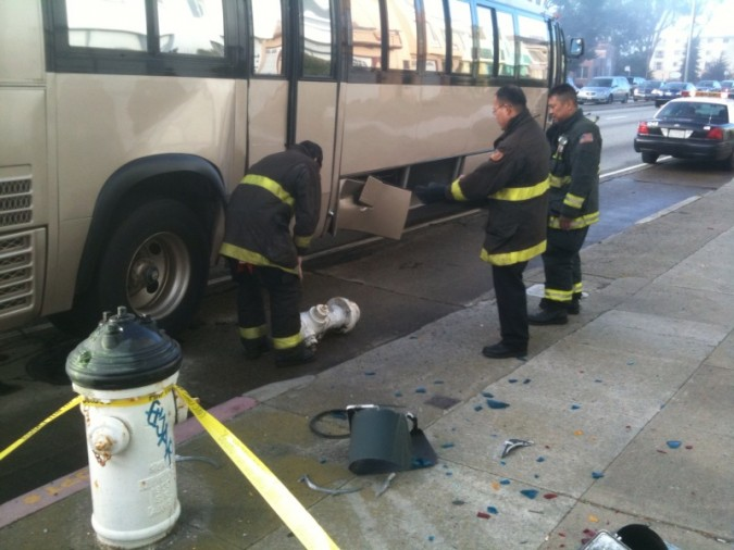 Fireman inspecting hydrant after it was removed from under bus conversion