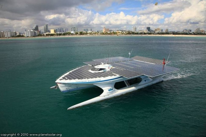planet solar boat showing slide out solar panel 'wings'