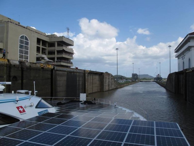 Planet Solar electric yacht navigating through the Panama Canal