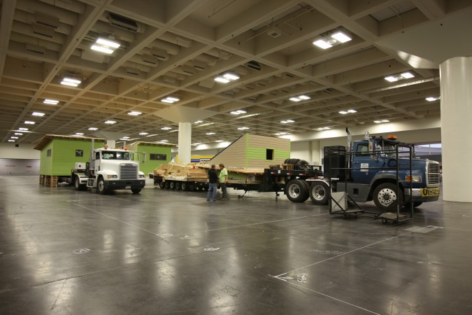 New Avenue, Inc. homes being unloaded inside Moscone Center, June 17, 2011. Photo by Kevin Warnock.