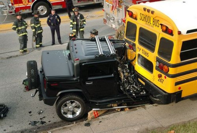 Hummer hits school bus (photographer unknown)