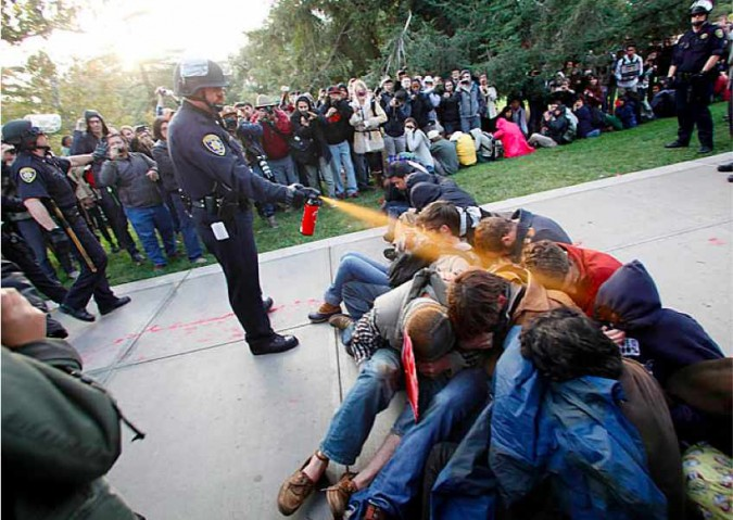 UC Davis police officer pepper sprays student protesters, November 18, 2011. Photograph by Wayne Tilcock of The Davis Enterprise.
