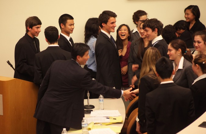 Both teams talk after the trial. Picture includes: Clifford Yin, Marcus Wong, Negative Nancy, Havel Weidner, Malia Bow, Nico Scolieri, Cristina Rey, Elizabeth Levinson and others. San Francisco Mock Trial finals, February 23, 2012.