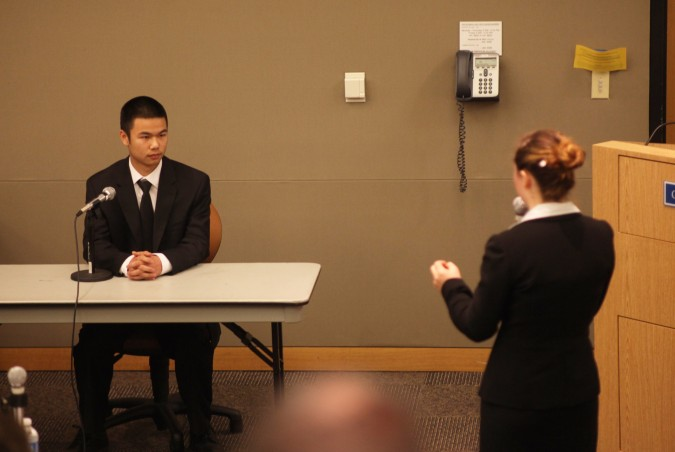Marcus Wong, playing a police officer, is questioned by student playing attorney for the defense at San Francisco Mock Trial finals 2012, February 23, 2012