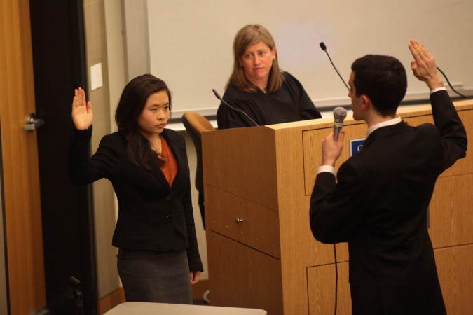 Witness sworn in by bailiff during San Francisco Mock Trial finals, February 23, 2012.