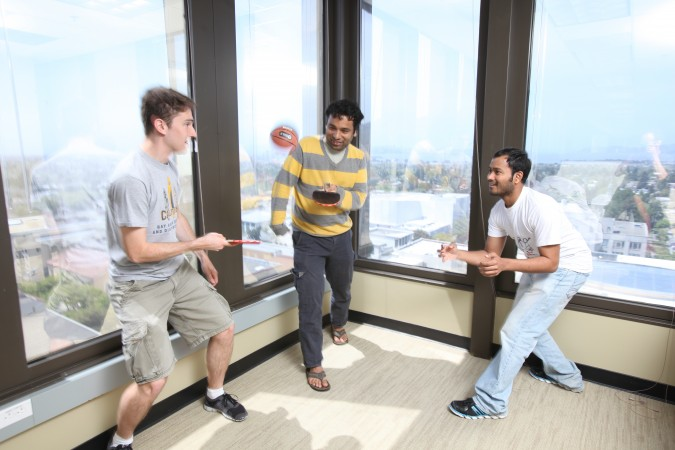 Picatcha.com team playing ping pong with a basketball. May 2, 2012, at University of California Berkeley Skydeck startup accelerator. Photograph by Kevin Warnock.