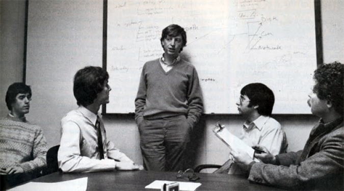 Andrew Fluegelman, on the far right, interviewing Bill Gates, standing, in 1984. Photographer unknown.