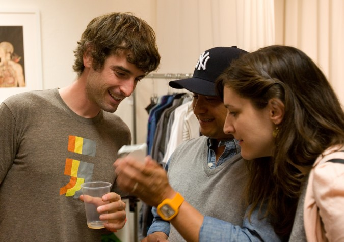 Aaron Schwartz, left, CEO of Modify Watches, checks out an Apple iPhone app August 9, 2012 at Hanger 16 at 3128 16th Street, San Francisco, California USA