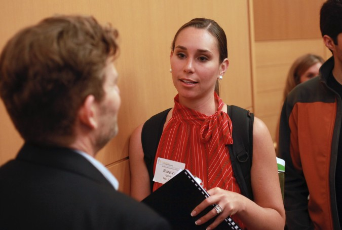 Moderator Sam Angus listens to student Rebecca Spitzer pitch her startup at the Berkeley Entrepreneurs Forum, August 30, 2012