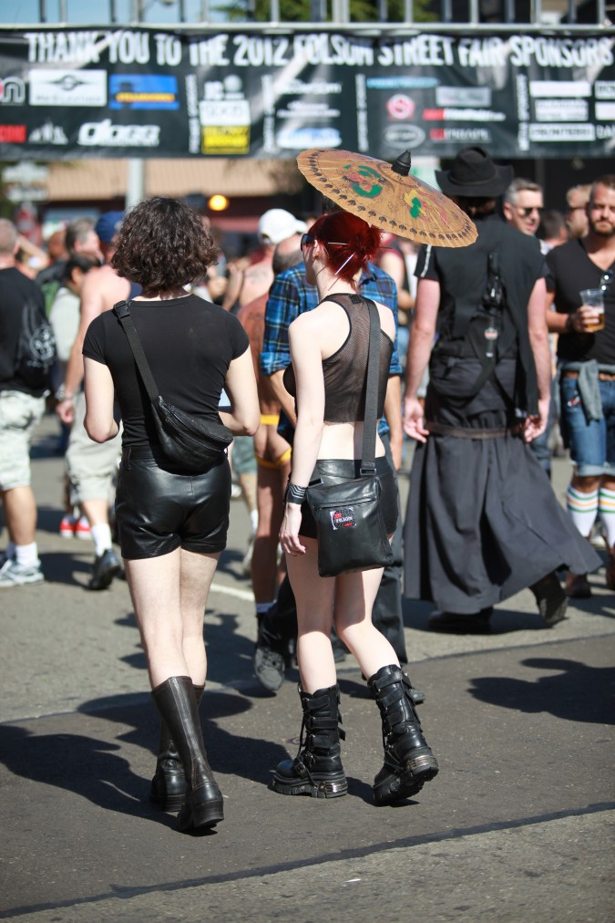 A couple walks together in the Sun at the San Francisco Folsom Street Fair, September 23, 2012.