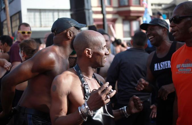 A group of men talking at the San Francisco Folsom Street Fair, September 23, 2012.
