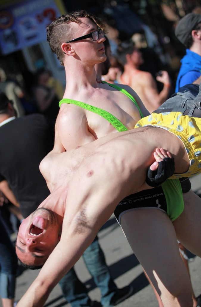 San Francisco Folsom Street Fair, September 23, 2012. Man lifting a man off the ground.