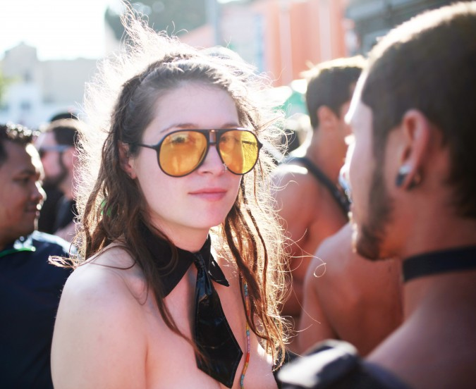 Woman with large yellow glasses at the San Francisco Folsom Street Fair, September 23, 2012.