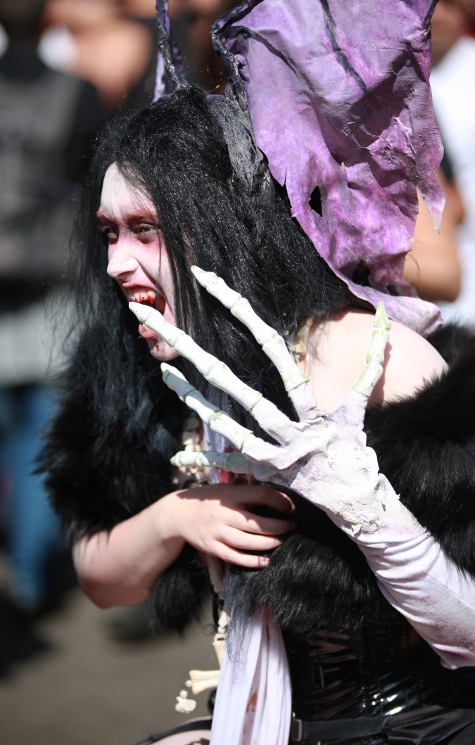 Woman with bloody teeth at the San Francisco Folsom Street Fair, September 23, 2012.