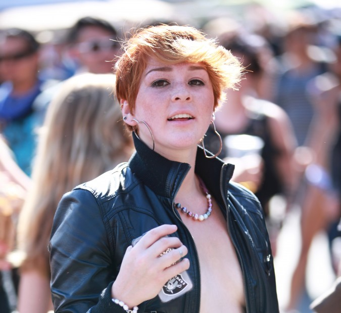 Woman with backlit red hair at the San Francisco Folsom Street Fair, September 23, 2012.
