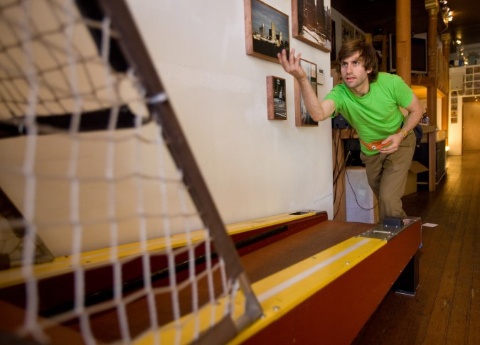 Joey Mucha playing his Skee Ball machine at D-Structure boutique on Haight Street in San Francisco California, October 20, 2012