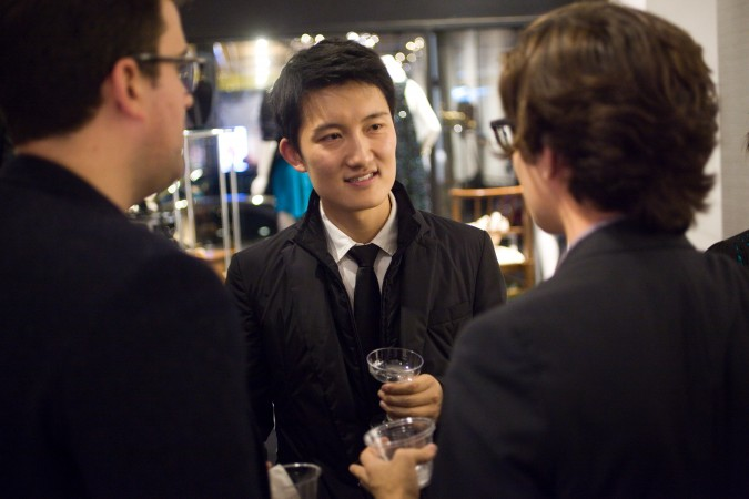 Leo Chen (center) talking with two guests at his launch party for his company's Apple iPad app 'Monogram', November 27, 2012, San Francisco, California USA