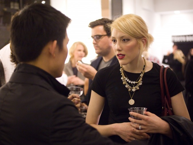 Leo Chen on left talks with guest at Monogram iPad app launch party, November 27, 2012, San Francisco, California USA