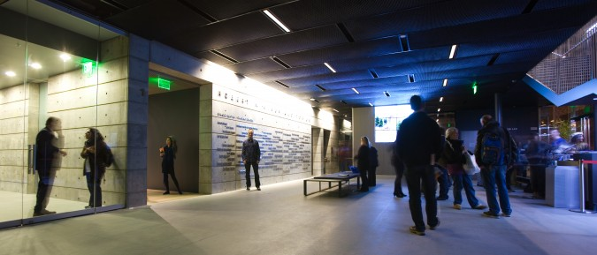 SFJAZZ Center, ground floor reception area, on opening night, January 21, 2013. Photographer and blogger Kevin Warnock is standing by the donor names on the wall.