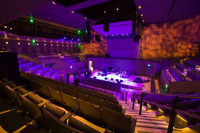 SFJAZZ Center Robert M. Miner Auditorium on opening night, under theatrical lighting, January 21, 2013, San Francisco, California USA. Photograph by Kevin Warnock.