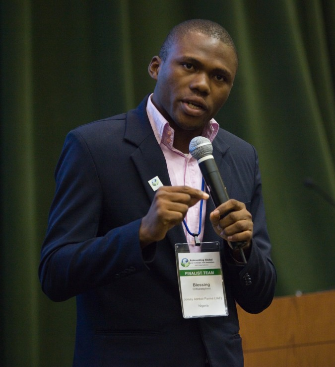 Meme B. Ortis, co-founder of Jorsey Ashbel Farms, delivering his Peoples' Choice winning pitch, at 2013 Global Social Venture Competition, April 12, 2013