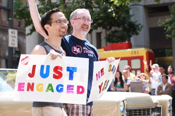 San Francisco Pride Parade and Celebration 2013 - picture 12, June 30, 2013, newly engaged gay couple, Photo by Kevin Warnock