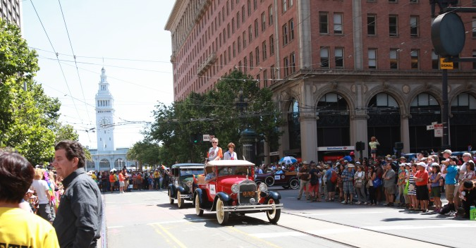 San Francisco Pride Parade and Celebration 2013 - picture 17, June 30, 2013, antique cars in parade make their way up Market Street, away from the Ferry Building in the distance
