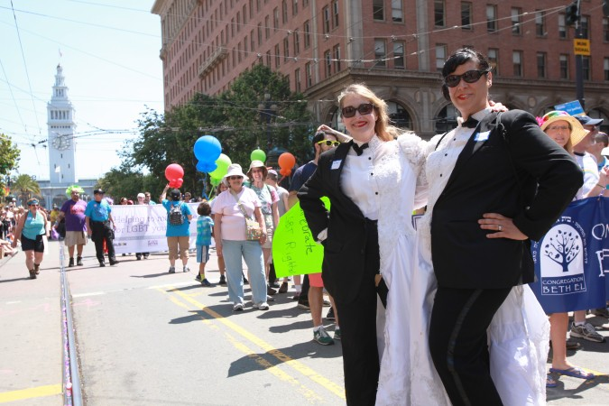 San Francisco Pride Parade and Celebration 2013 - picture 19, June 30, 2013, female couple each dressed in a half a wedding dress and half a tuxedo
